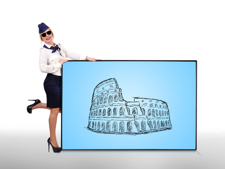 stewardess holding plasma panel with colosseum photo