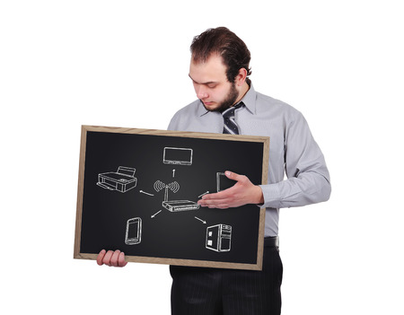 Businessman holding blackboard  with  drawing computer network photo