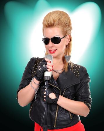 Beautiful sexy rocker girl singing expressive photo