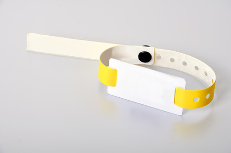 rfid: yellow rfid id bracelet, close up