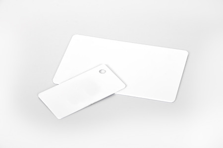two white RFID cards, close up photo