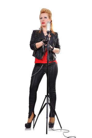 beautiful sexy girl standing near a microphone photo