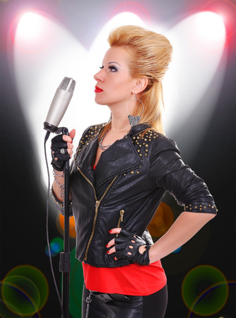 beautiful rock girl singer with microphone photo