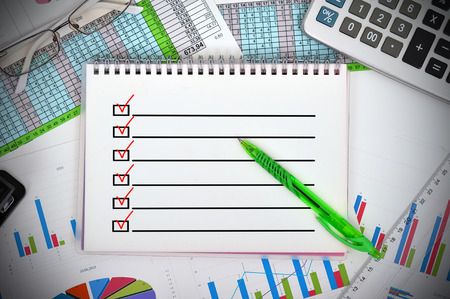 notebook with drawing check box and financial charts photo