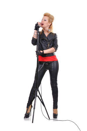 rock girl with microphone on white background photo