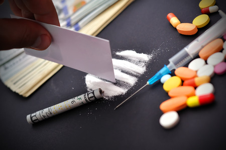 hand making a track from cocaine Stock Photo