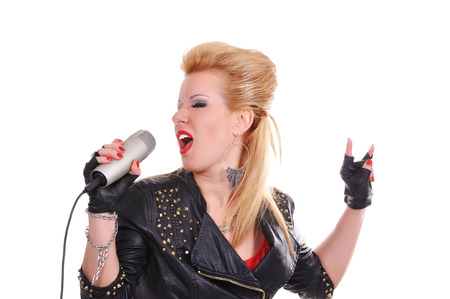 Beautiful rocker girl singing expressive photo