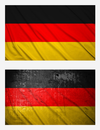 Waving and grunge flags of Germany photo