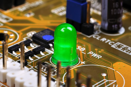 proto: Green LED on yellow circuit board, close up Stock Photo