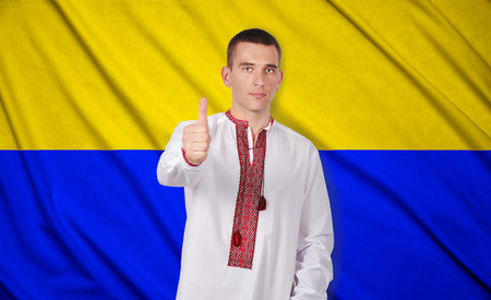 man in Ukrainian embroidered shirt with thumb up photo