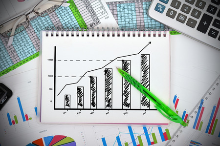 notebook with drawing graph and financial charts photo