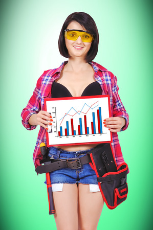 girl holding clipboard with chart on a green background photo