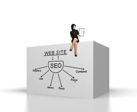 keywords link: businesswoman sitting on big cube with drawing seo concept