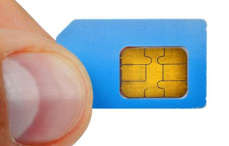 finger holding sim card isolated on white background photo