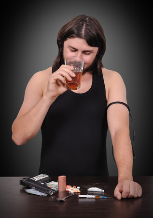 drinking alcohol: addict man drinking alcohol from a glass