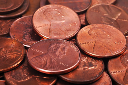 debt collection: pile of one cent coins isolated on white background Stock Photo