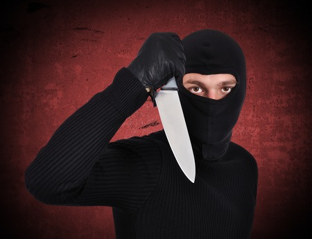 man holding knife on a red background photo