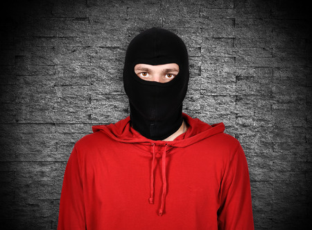 robber with red hoodie and black glasses photo