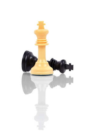 white chess king defeated black chess king photo
