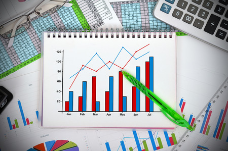 growth concept: notebook with drawing graph and financial charts Stock Photo