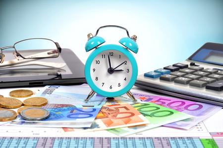 clock and euro money on desktop businessman