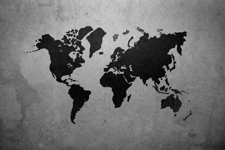 geography map: world map drawing on gray concrete wall