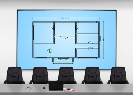 executive apartment: big plasma screen with blueprint in office Stock Photo