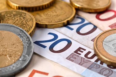 pay money: euro banknote money and coins, close up Stock Photo
