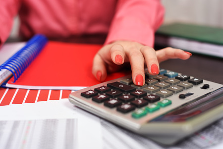 considers: girl with a calculator considers the household budget