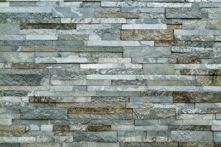 rock texture: wall of gray stone finishing, close up