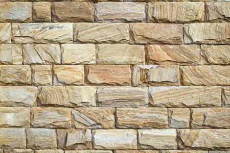 yellow stone: pared de piedra amarilla de acabado, de cerca