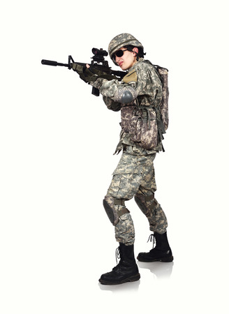 fatigues: American soldier with rifle  on white background