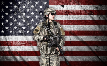 fatigues: US soldier with rifle on usa flag background