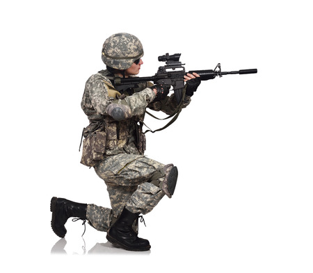 fatigues: American soldier kneeling with rifle