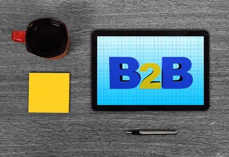 b2b: Touch Pad con b2b en la mesa gris Foto de archivo