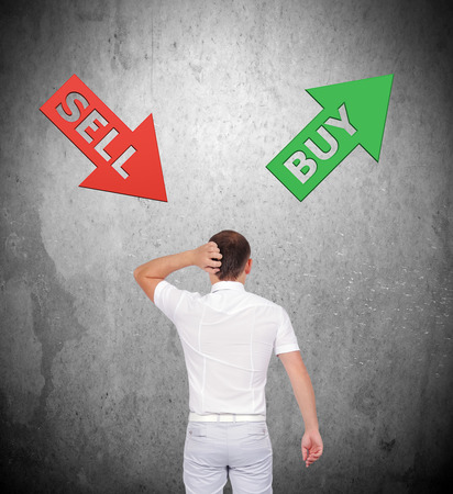 sel: businessman thinking with sel and buy arrow over head
