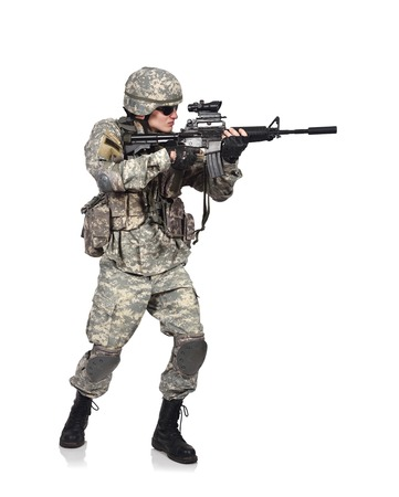 fatigues: US soldier holding his assault rifle isolation on white