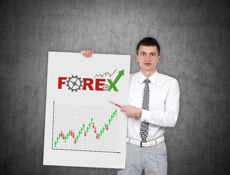 stock predictions: young businessman holding placard with stock chart