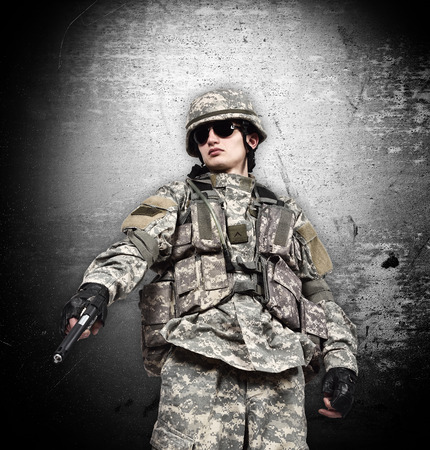 fatigues: american soldier with gun on a black background Stock Photo