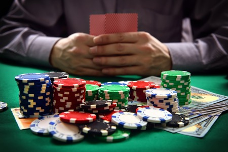 man with two cards playing in poker, close up photo