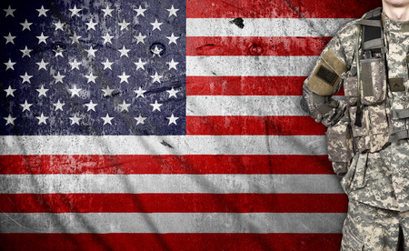 armed services: USA soldier on a american flag background Stock Photo