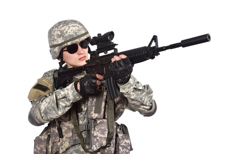 fatigues: US soldier with rifle on a white background Stock Photo