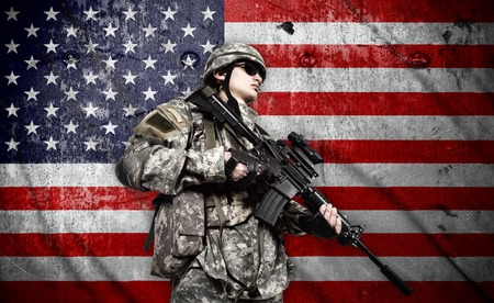 fatigues: soldier holding rifle on a american flag background