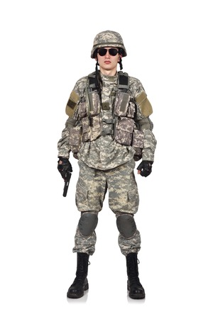 fatigues: USA soldier with gun standing on a white background