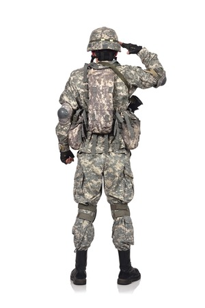 fatigues: US soldier salutes standing back on white background