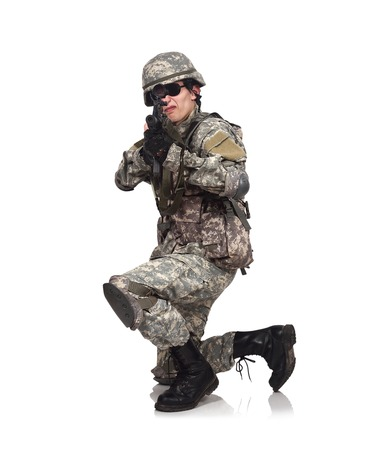 fatigues: soldier aiming with rifle  on a white background Stock Photo