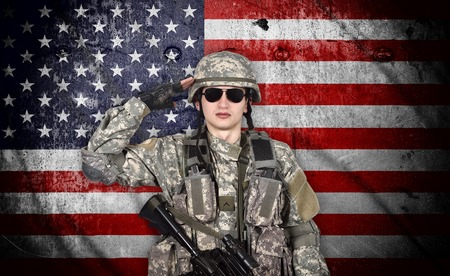 salutes: soldier salutes the American flag on the background