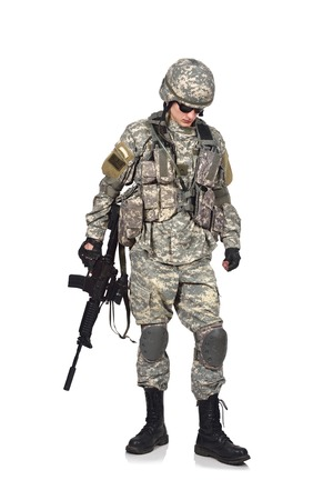 fatigues: soldier holding his assault rifle isolation on white