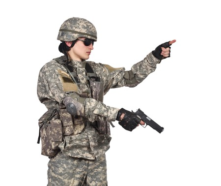 militant: soldier with gun on a white background Stock Photo