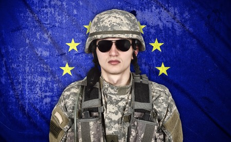european union flag: american soldier and European Union flag on background Stock Photo